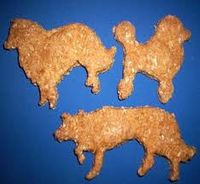 http://www.etsy.com/listing/27072257/poodle-shaped-dog-cookies-in-liver