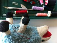 Sheep Toy Gets Red Stitches