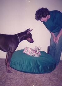Maggie the Doberman waits to open her gift